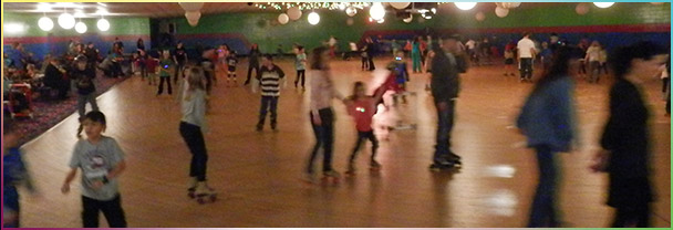 People rollerskating at Skateville